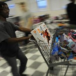 Adolphus Ames wheels a shopping cart full of toys to a nearby table as he and fellow Northampton High School honor society members organize a large pile of toys by gender and age group as they help prepare for the Northampton County Social Services Toy Closet on Monday, Dec. 14, 2015. The Toy Closet will donate toys to more than 350 county children this year.