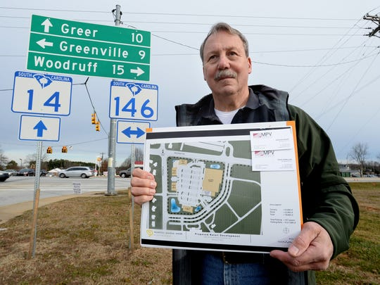 Harvey Kennedy holds the plans for a proposed retail development that is being considered for the corner of Woodruff Road and Hwy. 14 in Simpsonville. Kennedy, who lives near the corner, is among a group that is fighting the rezoning of the area.