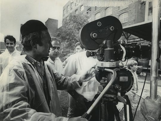 Director Norman Jewison sets up a shot on the set of
