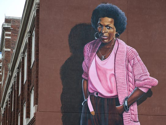 A completed mural depicting poet Mari Evans along Massachusetts