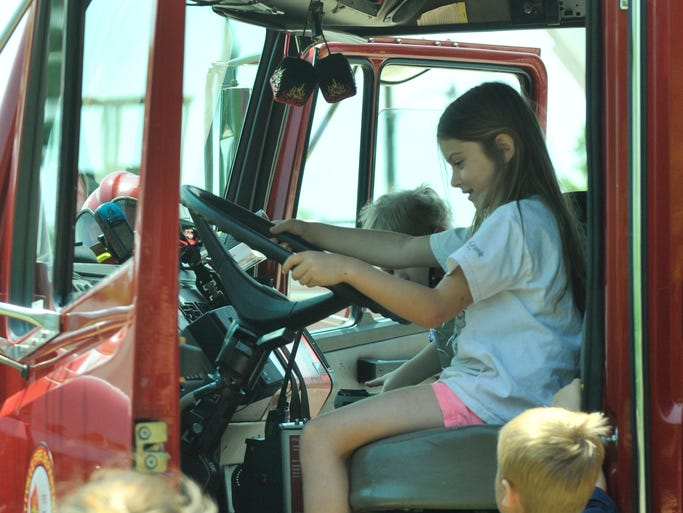 Braelyn Creamer enjoys time in the seat of a firetruck at the City of Prattville's Fifth Annual Touch-A-Truck event at Pratt Park on Saturday, May 17, 2014.