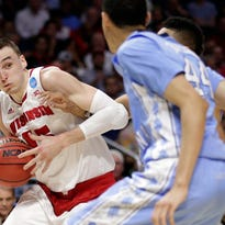 Wisconsin forward Sam Dekker (left) and the Wisconsin Badgers will take on the Arizona Wildcarts in a rematch of last year's NCAA Tournament West regional final today at Staples Center in Los Angeles.