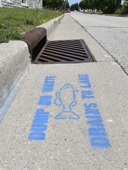 """The message is """"Dump No Waste; Drains To Lake.''"""