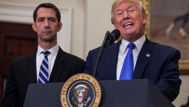 President Trump endorses the Reforming American Immigration for Strong Employment (RAISE) Act with Republican Senator from Arkansas, Tom Cotton (L), and Republican Senator from Georgia. David Perdue (out of frame), in the Roosevelt Room of the White House on Aug. 2, 2017.