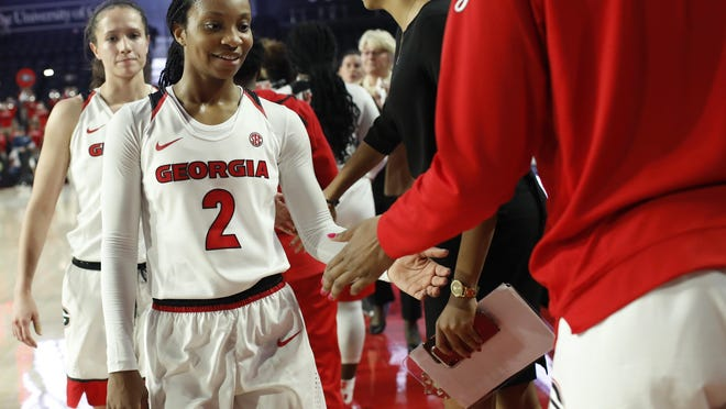 Georgia guard Gabby Connally (2) smiles big after putting up 28 point to lead her team to victory during an NCAA women's basketball game between Georgia and Kennesaw State in Athens, Ga., on Thursday, Nov. 7, 2019.