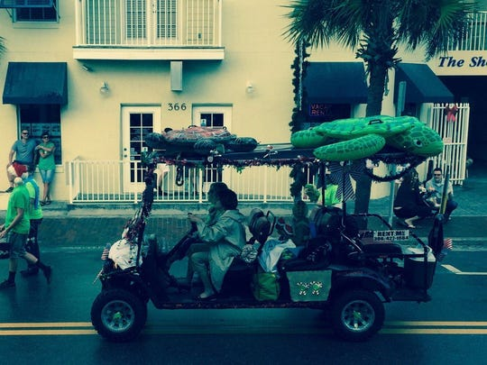 "Christmas season and the annual Christmas parade in New Smyrna featured a golf cart with a ""Save the Turtles"" theme. There are lots of golf carts all year round on Flagler Avenue."