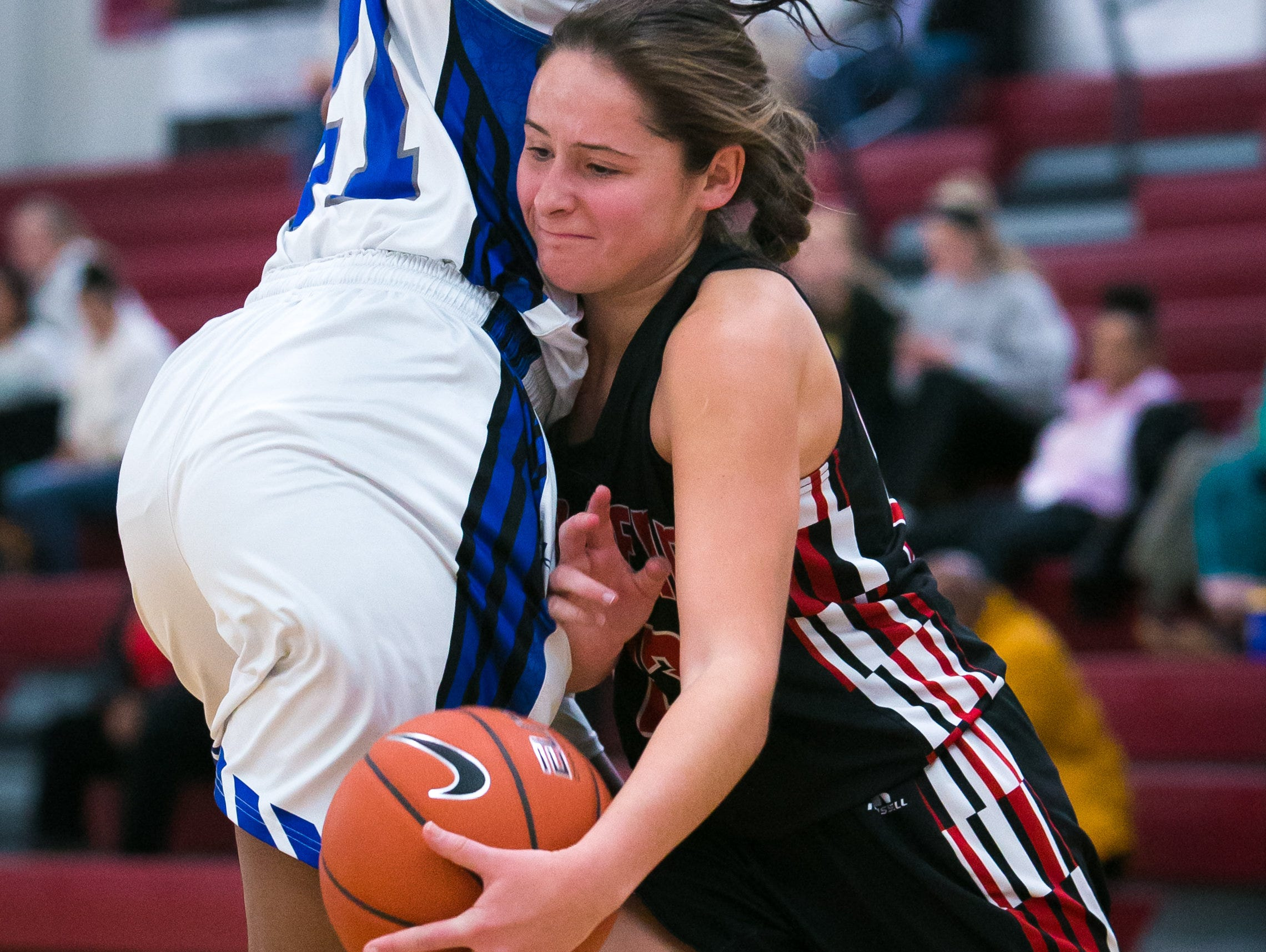 William Penn forward Jessica Behomar (right) makes contact with Howard center Kayla Rouse as she drives to the basket.
