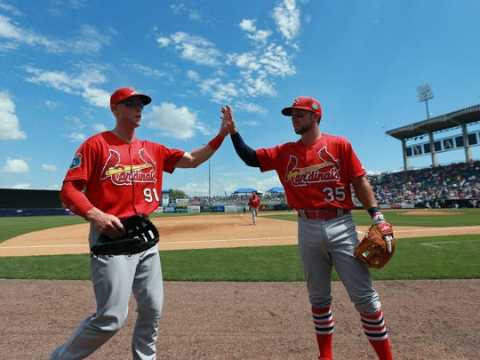 Mar 31, 2016; Tampa, FL, USA; St. Louis Cardinals right fielder Jeremy Hazelbaker (91) and second baseman Greg Garcia (35) high five against the New York Yankees at George M. Steinbrenner Field.