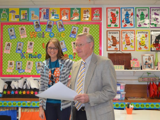 Lance Spruiell (right), board president of the Wichita Falls ISD Foundation, surprises Ben Milam teacher Amanda Miller with an IDEA grant award. She and fellow Milam teacher Tiffany Hutchison submitted a grant application to buy Osmo, an iPad accessory to be used in math and literacy centers and during small class instruction.