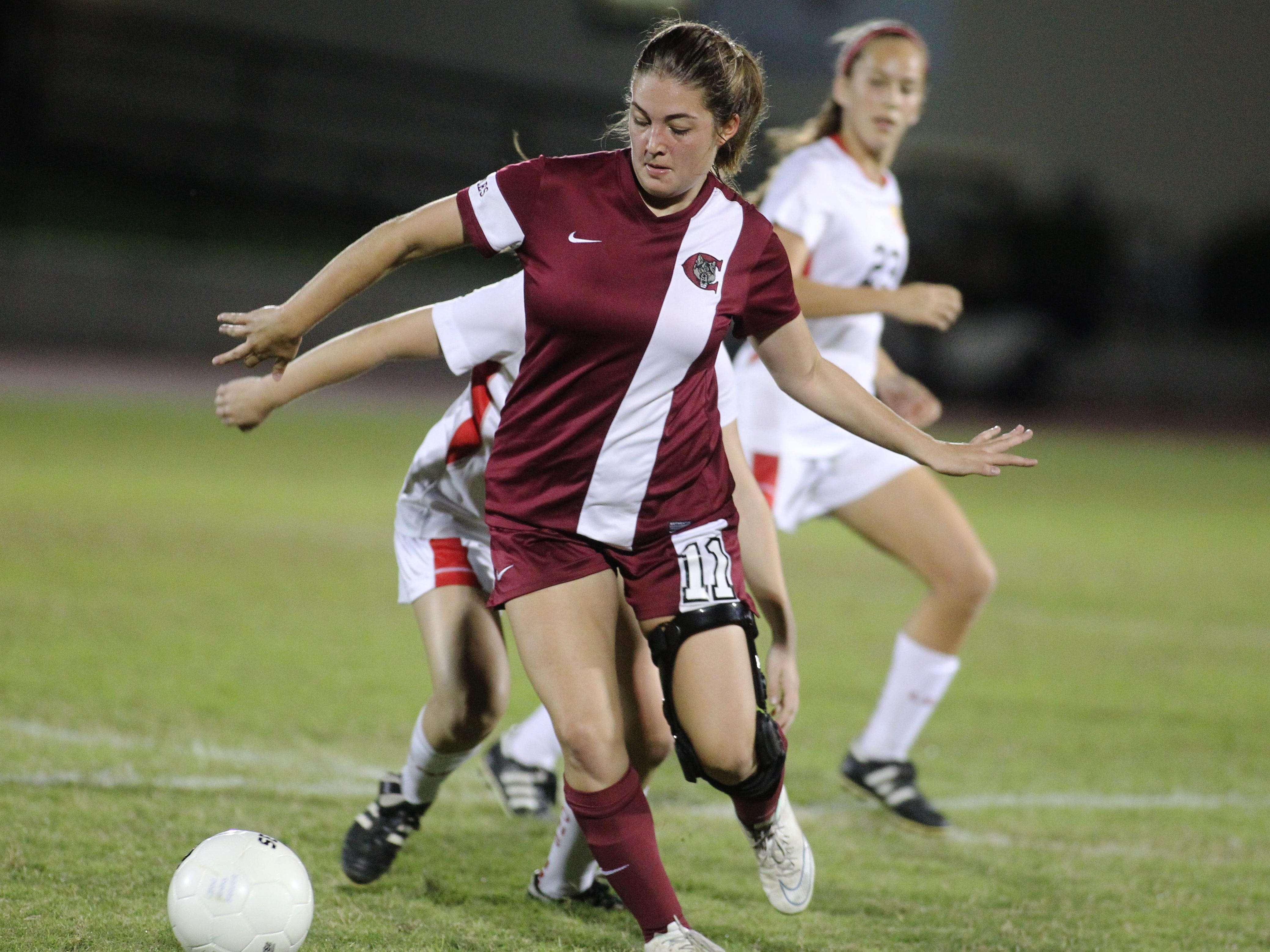 Chiles' Sydney Martin runs with the ball in a game between Leon and Chiles.