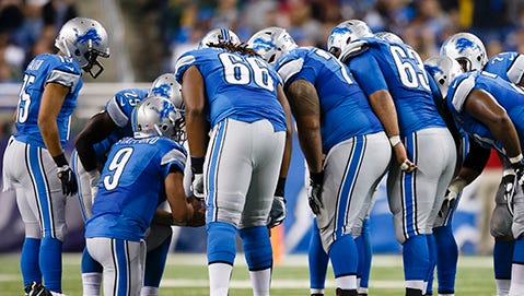 Detroit Lions quarterback Matthew Stafford (9) huddles up the offense against the Green Bay Packers during an NFL football game at Ford Field in Detroit, Thursday, Dec. 3, 2015. (AP Photo/Rick Osentoski)