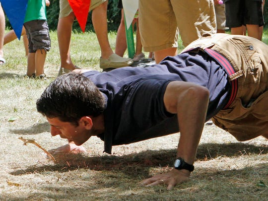 Congressman Paul Ryan gets his frog to jump during the annual  frog-jumping contest at Dousman Derby Days. This year's Derby Days festival is planned for July 27-29.