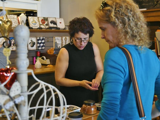 Paula Marvin, owner of Exeter's Rosemary and Thyme rings up a customer during Small Business Saturday.