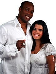 Former New England Patriots football player Jerod Cherry (seen here with his wife Samua) donated his Super Bowl ring from the Patriots' victory over St. Louis in Super Bowl XXXVI, to Asia's Hope.