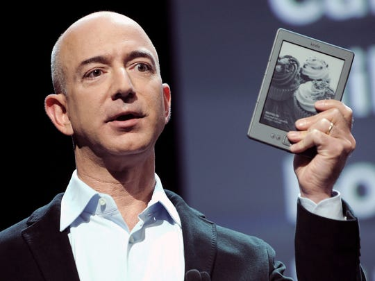 Jeff Bezos, CEO of Amazon.com, holding a  Kindle