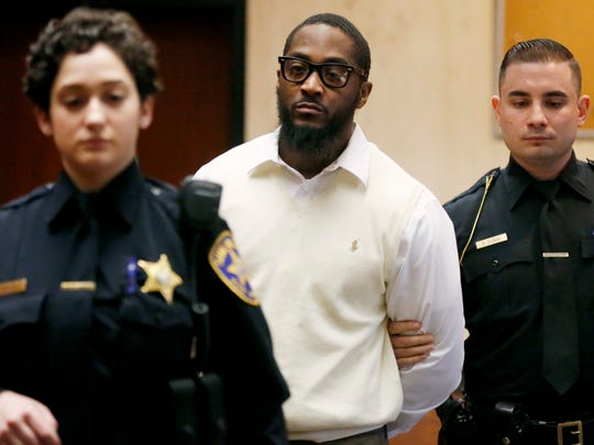 Essex County Sheriff's officers lead Basim Henry, one of four men charged with the December 2013 fatal shooting and carjacking of Dustin Friedland at an upscale New Jersey mall, into court where a jury found him guilty on all counts for his role in Friedland's murder, Friday, March 31, 2017, in Newark, N.J.