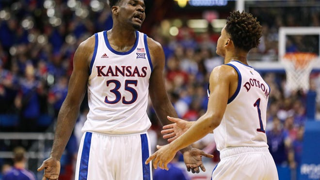 Former Kansas basketball center Udoka Azubuike, left, was drafted No. 27 overall by the Utah Jazz in the NBA Draft on Wednesday night.