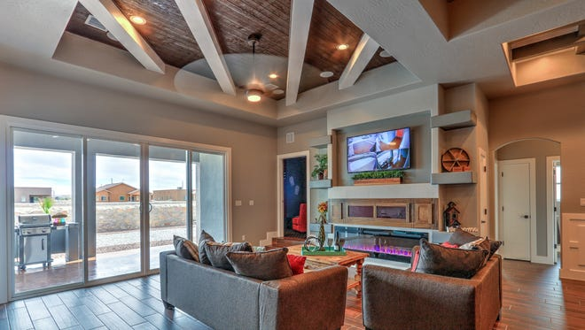 """Deal 2 Deal Homes' built a four-bedroom home with a """"rustic farmhouse theme,"""" using lots of wood elements, including on the ceiling in this family room, for this year's Parade of Homes in the Upper Valley."""