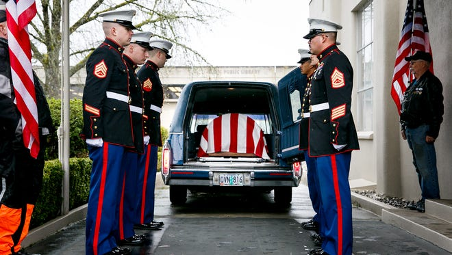 Marines from the 6th Engineer Support Battalion, based in Portland, prepare to carry the casket of Marine Pfc. Lyle E. Charpilloz into Virgil T. Golden Funeral Service on Thursday, April 5, 2018, in Salem.