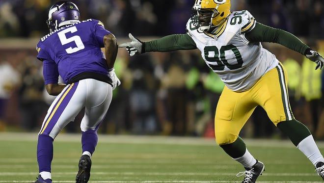 Green Bay Packers defensive tackle B.J. Raji (90) reaches for Minnesota Vikings quarterback Teddy Bridgewater (5) in the fourth quarter during Sunday's game at TCF Bank Stadium in Minneapolis, Minn.