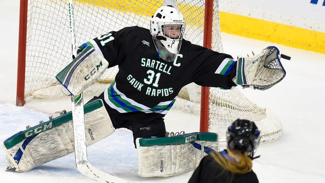 Sartell/Sauk Rapids goalie Clare Minnerath reaches for a puck that was shot wide against Hill-Murray during the first period of the Class 2A quarterfinal Thursday, Feb. 18 at the Xcel Energy Center in St. Paul.