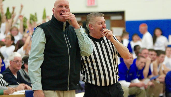 It's not all bad blood between coaches and officials. James Buchanan boys basketball coach Larry Strawoet, left, shares a laugh with official Barry Shipley during a game at Waynesboro last year.