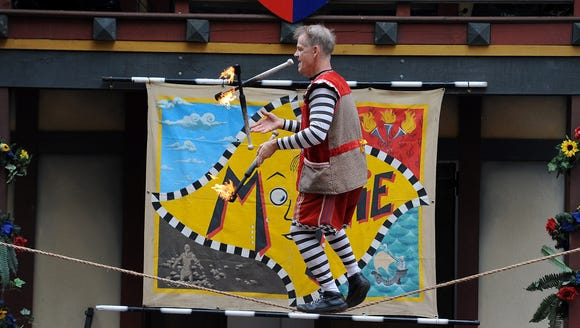 """Comedian and juggler """"Moonie"""" performs in 2014 at the"""