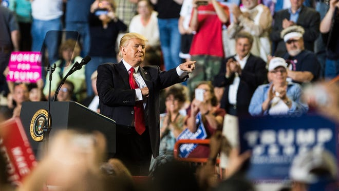 President Donald Trump addresses the crowd as during a rally at the Farm Show Complex in Harrisburg on Saturday, April 29, 2017, the 100th day of his presidency.