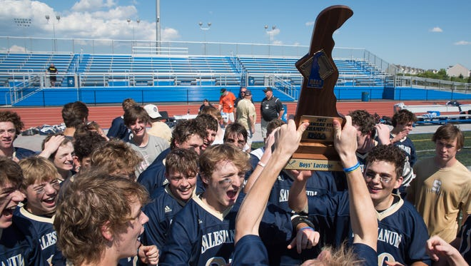 Salesianum celebrates winning the DIAA Boys Lacrosse Championship against Cape Henlopen at Dover High School.