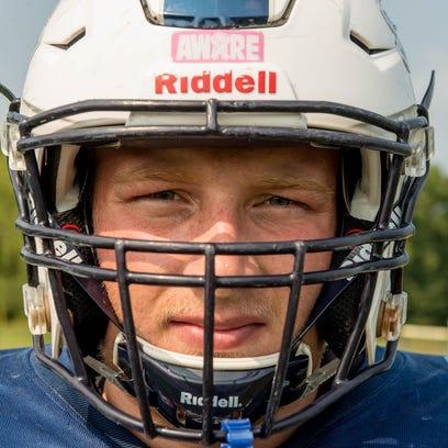 Maple Valley senior Marcum Terpening with new helmet