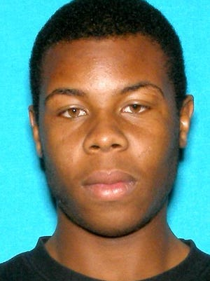 Tyshune Neely is wanted for allegedly slashing a police officer with a knife on Tuesday.