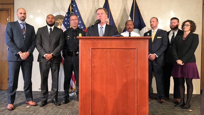 Mayor Joe Hogsett announces Indianapolis will pursue legal action against opioid manufacturers and distributors during a press conference on Thursday, Oct. 5, 2017.