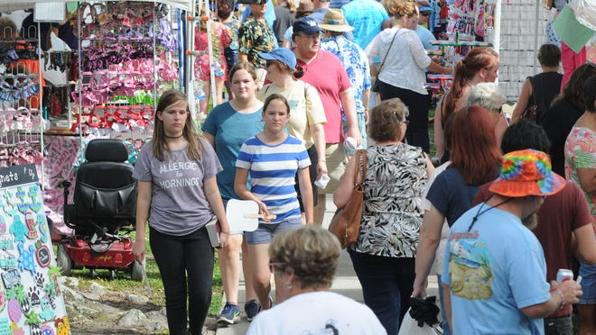 Crowds browse past some of the many vendors at the 14th annual N.C. Blueberry Festival in Burgaw, N.C., Saturday, June 17, 2017. The festival included a car show, bands, a variety of vendors and many blueberry related food and drink options. [STARNEWS FILE PHOTO]