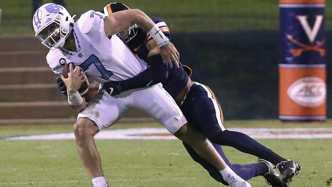 Virginia linebacker Charles Snowden, right, sacks North Carolina quarterback Sam Howell during Saturday night's game.