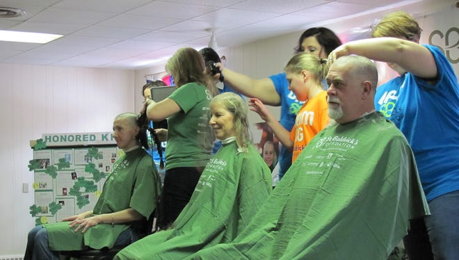 People get their heads shaved at the 2015 St. Baldrick's Shave-a-Thon. This year's event, which raises money for childhood cancer awareness, will take place on Sunday.