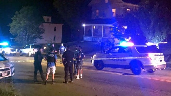 Worcester police gather in front of 52 May St. on Friday night, the scene of a reported shooting.
