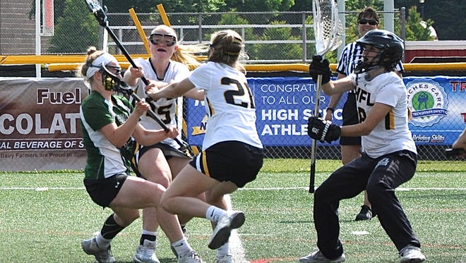 Honeoye Falls-Lima goalie Kierin Ratliff snares shot from Brewster's Sam DeLeo during Friday's state Class C semifinal. HF-L won 10-9 to advance to Saturday's championship.