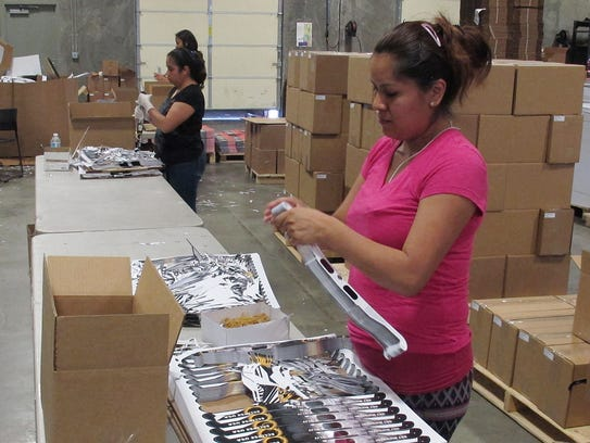 Employees prepare solar eclipse glasses for shipping