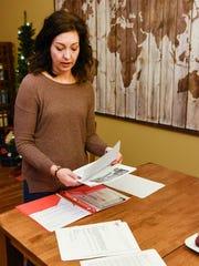 Julie Meyer, Sartell, looks through some of her paperwork