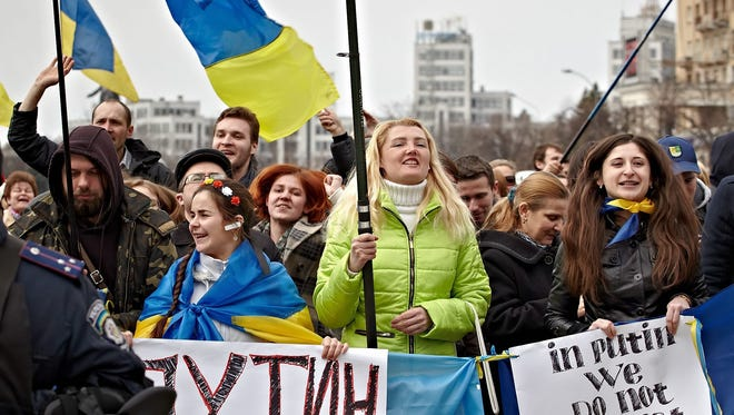 Supporters of Single Ukraine attend a rally in front of the regional administration building  in Kharkiv, Ukraine, on April 7. Masked men were controlling the entrance of the building, the Interfax Ukraine news agency reported.
