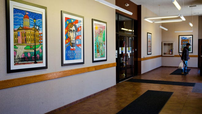 Five of Mike Manning's paintings of Springfield are visible Wednesday in the lobby in front of US Bank's downtown Springfield location at 205 S 5th St.