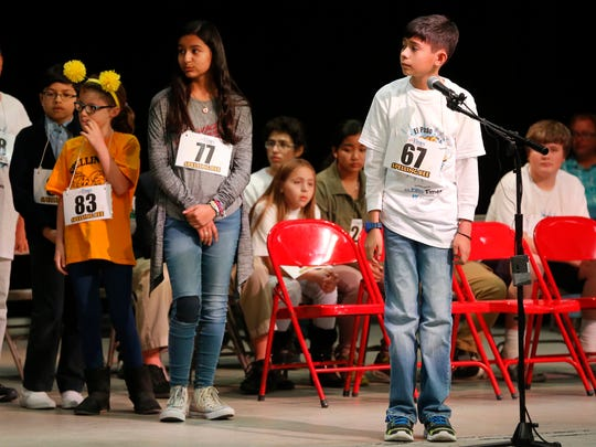 Dylan Brown, representing Edgemere Elementary School, awaits his next word during the finals of the 2018 El Paso Times Spelling Bee on Friday. Other spellers stand behind him waiting on their turn at the microphone and a chance to move on.