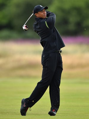 Tiger Woods, a three-time British Open champion, tees offs during his Tuesday practice round at prior to the start of The 143rd Open Championship at Royal Liverpool.