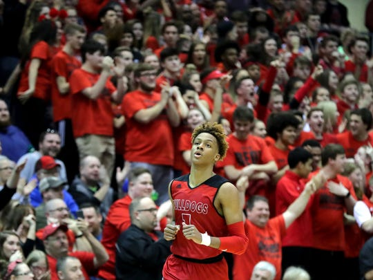 The crowd cheers on New Albany's Romeo Langford, after he scored against Seymour in the Class 4A Sectional semifinals on March 2, 2018.