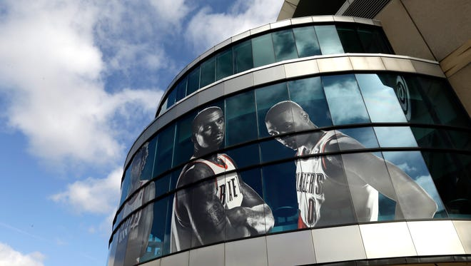 Likenesses of Portland Trail Blazers LaMarcus Aldridge, left, and Damian Lillard adorn the outside of the Moda Center arena in Portland, Ore., Wednesday, April 22, 2015.  The Trail Blazers, who play the Memphis Grizzies in Memphis tonight for Game 2 of their NBA first round playoff games, will return to the Moda Center Saturday for Game 3.