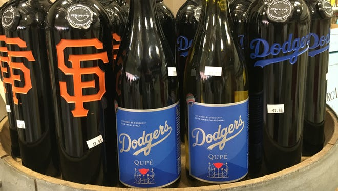 Wines bearing baseball-team logos are seen at Ventura Wine Co., a combination wine bar and retail shop in Ventura.