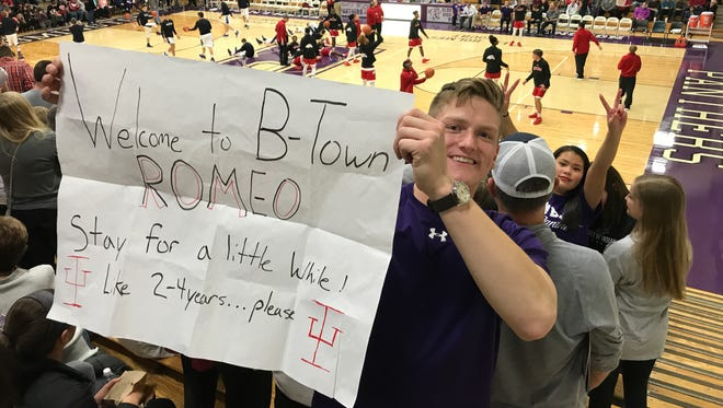 Drew Miller, an IU student, did his part to convince Romeo Langford to play for the Hoosiers with this sign.