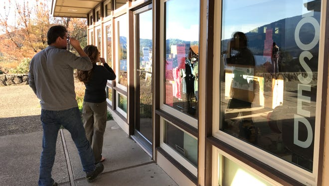 Mike and Donna Scholl of Redding read the closed notice at the Whiskeytown National Recreation Area Visitors Center on Saturday. The center was closed but the park was open following Friday night's government shutdown.