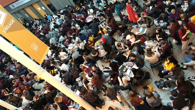 Students fill up the Damen Student Center on the campus at Loyola-Chicago for an Elite Eight watch party.