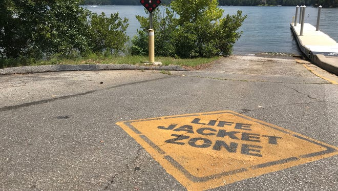 Signs are displayed in various areas of Lake Keowee that urge lake-goers to wear life jackets.